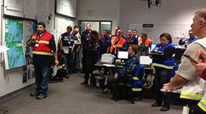 Response personnel gather to hear an update on the drill's progress. Photo by Amanda Johnson.