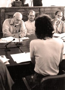 Cordova resident Riki Ott (facing away from camera) speaks during a board meeting in September 1991. Board members pictured (left to right): Stan Stephens, Tim Robertson, and Bill Walker.