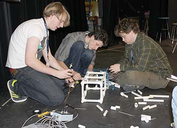 The first place winning team from Homer working together to create their ROV.