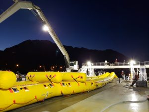 Photo of crews practicing oil spill response at night.