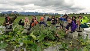 Alaska students learned about environmental stewardship and how the effects of an oil spill can spread during a recent expedition into Prince WIlliam Sound. Here, they pose next to a Dusky Canada goose nest island they helped the U.S. Forest Service to maintain.