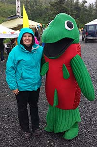 Lisa Matlock makes a new friend at the 2014 Copper River Wild! festival in Cordova.