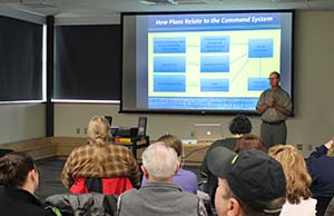 Tim Robertson, council contractor, leads a discussion during the Seward workshop on how contingency plans relate to the Incident Command System. Photo by Amanda Johnson.