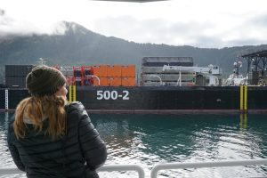 "Photo of an onlooker viewing the oil spill support barge, the ""500-2"". This barges carries response equipment such as skimmers and boom."