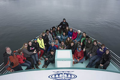 Lisa Matlock, center, poses with the Seward High School students and teachers in the bow of the Glacier Explorer.