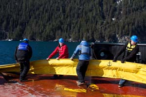 Participants help recover boom during this year's training in Seward. Photo by Jeremy Robida.