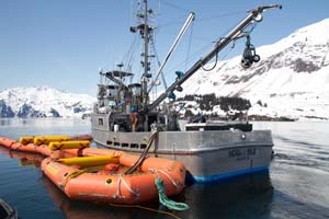 The buster, shown here during the Valdez training, has a collection area at the rear and a skimmer can be set inside to recover oil and oily water. Photo by Jeremy Robida.