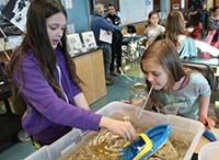 At the Homer oil spill Discovery Lab, students demonstrate the effects of wind on oil distribution.