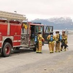 Firefighters participate in a simulated vessel fire exercise at the Valdez harbor. Photo by Nelli Vanderburg.