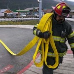 Firefighters participate in a simulated vessel fire exercise at the Valdez harbor. Photo by Zac Schasteen.