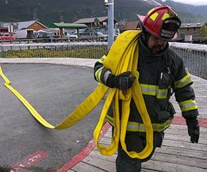 Firefighters participate in a simulated vessel fire exercise during the 2015 Marine Firefighting Symposium at the Valdez harbor. Photo by Zac Schasteen.