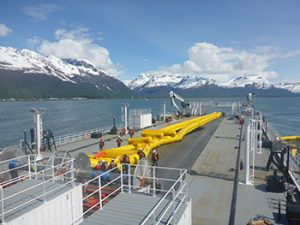 Another view of the Current Buster 8 fully inflated onboard an oil spill response barge.