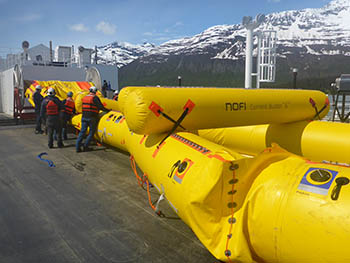 The decks of the new oil spill response barges are large enough to completely inflate the new Current Buster 8 oil spill boom on board, rather than partially inflating in the water. The new method is easier and safer for the crews.