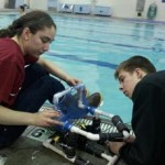 Valdez students make adjustments to a remotely operated vehicle they designed and built during a recent program by the Prince William Sound Science Center. The students used the vehicles to respond to a mock oil spill. Photo by Kara Johnson.