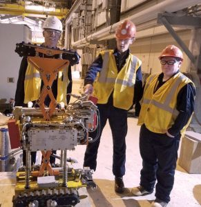 Council Board President Amanda Bauer, staffer Austin Love, and Terminal Operations and Environmental Monitoring Committee volunteer Steve Goudreau check out one of the new robotic crawlers during a visit to the terminal in 2016.